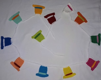 Crocheted garland with colorful funny hats for children's birthday, carnival, party decoration, nursery and kindergarten