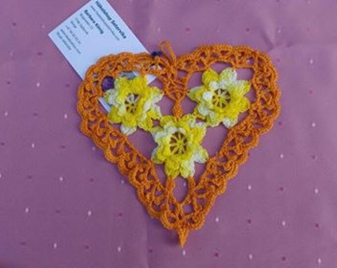Crocheted heart cover with yellow 3d crochet flowers
