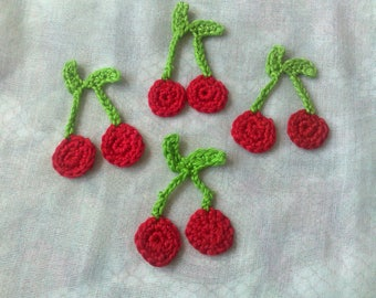 4 red cherry patches fake food and crochet toys