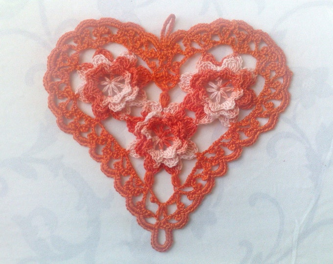 Orange crocheted Heart cover with 3d flower