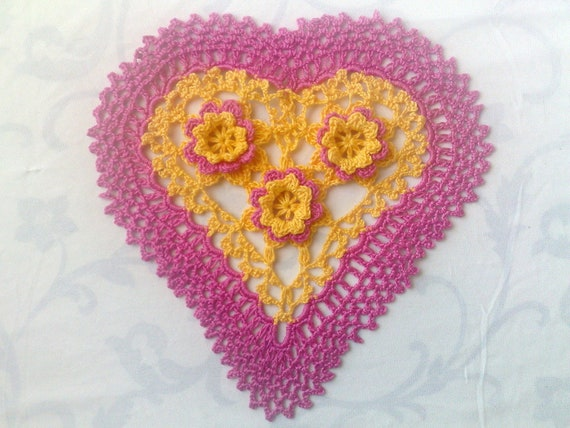 Pink crocheted heart cover with yellow pink 3d crochet flowers