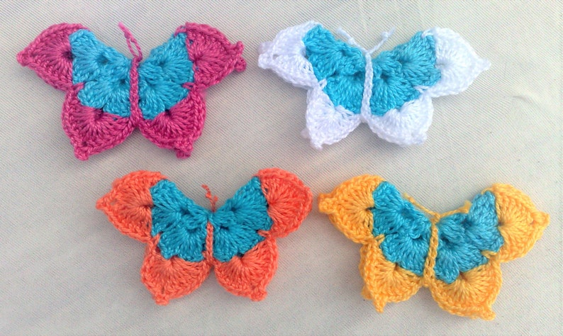 4 crocheted butterfly appliqués three-dimensional in colorful image 0