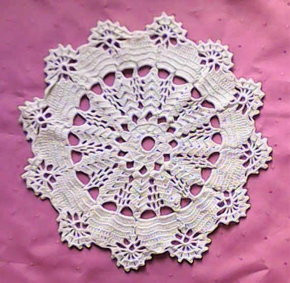 Natural white crocheted ornamental cover for table decoration