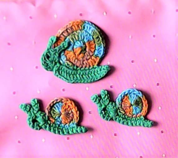 Crocheted applique snail 3 piece crochet application Closer crocheted in colorful gradient yarn
