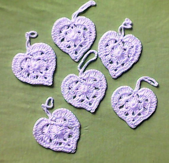 Crocheted hearts of blossom white cotton