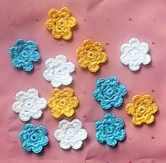 12 crocheted small Floral Appliqués, 3 cm in blue, white and yellow