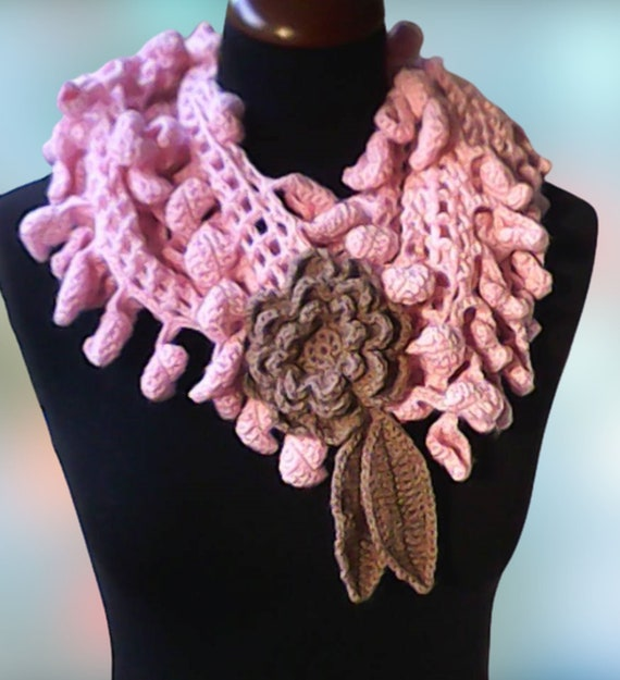 Pink lasso scarf with large grey crochet flower
