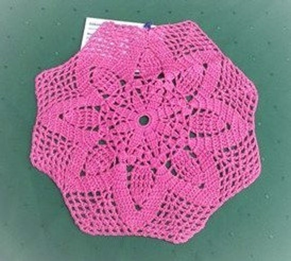 Crochet cover in dark pink cotton