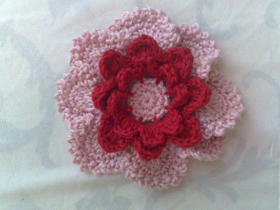 Large crocheted floral application for sewing on children's clothes