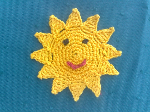 Crocheted Sun with a funny face for kids birthday decoration