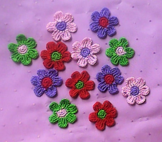 12 colorful Crochet Flowers in the Colors green, purple, pink and red