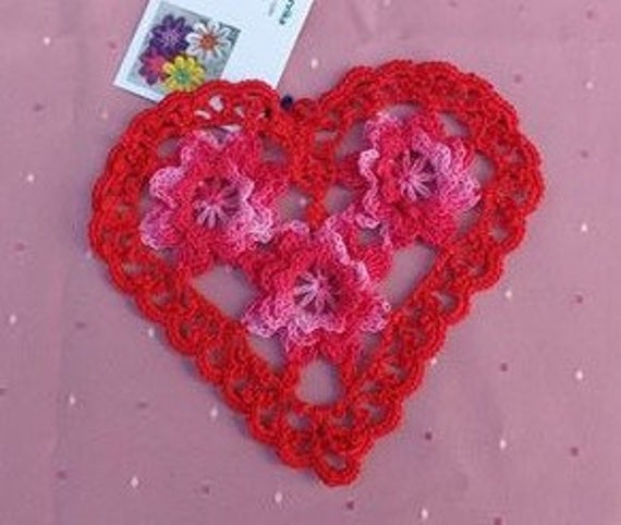 Red crocheted heart cover with 3d crochet flowers in pink and white