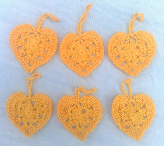 Decorate 6 pieces of yellow crocheted hearts for Birthday gift