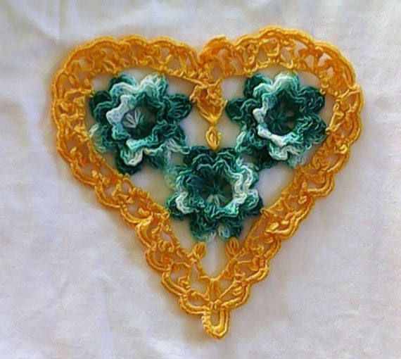Thanksgiving Yellow crocheted heart-shaped doily with 3D crochet flowers in turquoise