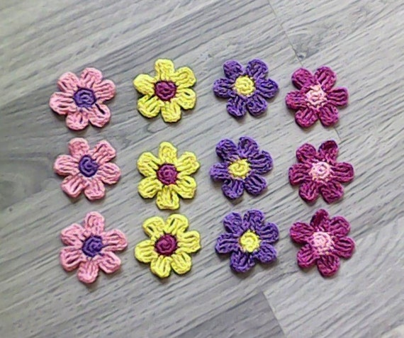12-piece crochet applique, patch in the colors pink, yellow, purple and cerise