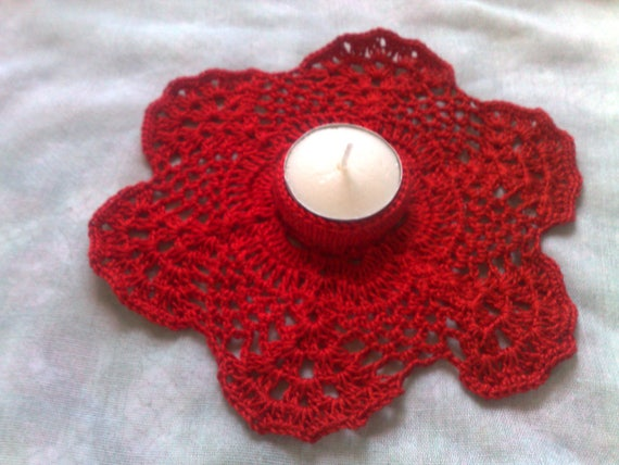 Red crocheted candle holder for a romantic dinner