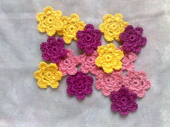 Crochet flower patch in pale yellow, cerise and pink