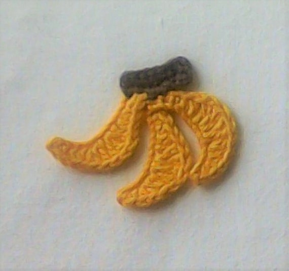 Cutting up crocheted Banana Handmade Crochet application Embellishment