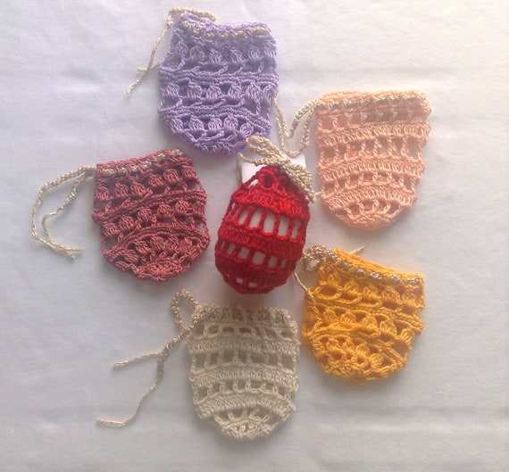Set of 6 crocheted Easter egg covers in white, yellow, pink, apricot, red and purple