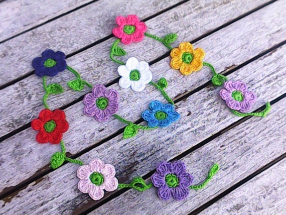 Crochet mini garland with 10 small colorful flowers red purple pink blue white and yellow