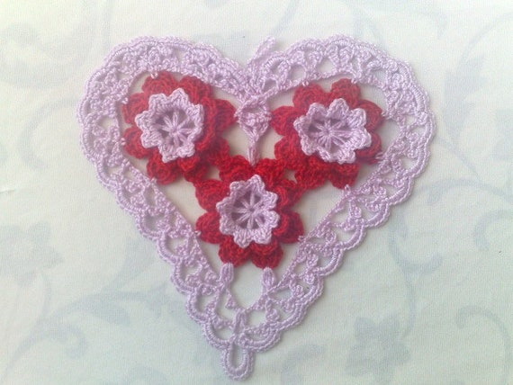 Light purple crocheted heart cover with red 3d crochet flowers
