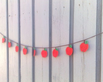 Crocheted garland with red apples