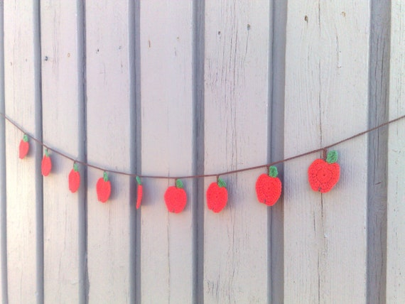 Crochet garland with red apples