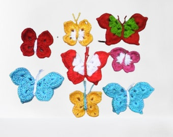 Crocheted butterfly applications. Set of 8 crocheted butterfly applications in different sizes and colors