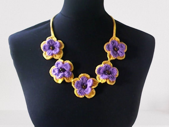 Crochet boho necklace with purple and yellow crochet flowers