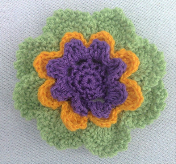 Larger crocheted Flower tri-colored in green, yellow and purple colors