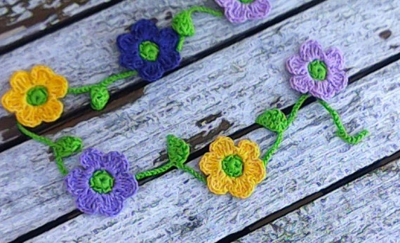 Crochet mini garland with 10 small colorful flowers yellow purple