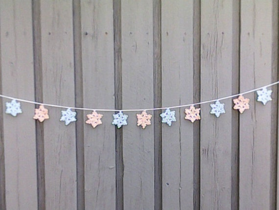 Crochet Christmas garland with 11 small snowflakes in light blue apricot for tree hanging and Christmas decoration