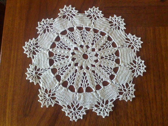 Natural white crocheted decorative cover for table decoration