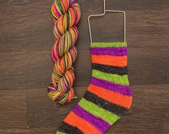 """Self Striping DK Weight Sock Yarn.  75/25 Superwash Merino/Nylon.  """"Happy Halloween""""."""