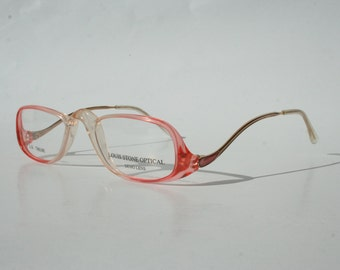 ac3993f9c25 Reading glasses in pale pink and clear plastic. Louis Stone.