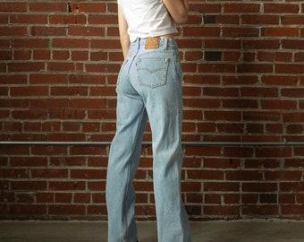 248430ce85 Vintage Levis Size 26 - 27 / 2 - 4 With 28 Inch Waist | 80s 90s Levi 501 |  Mid-High Rise Button Fly Light Wash Blue Jeans | USA Cotton Denim