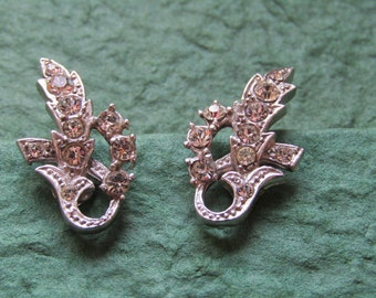 Silver toned diamante clip on earrings