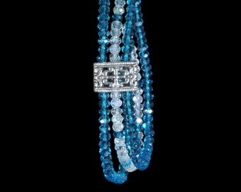 Sparkling stretchy triple strand teal and clear glass bracelet