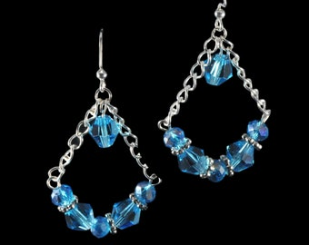 Summery aqua colored faceted glass bead earrings