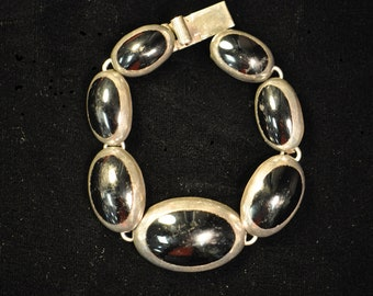 Vintage 925 Silver bracelet with black stones.