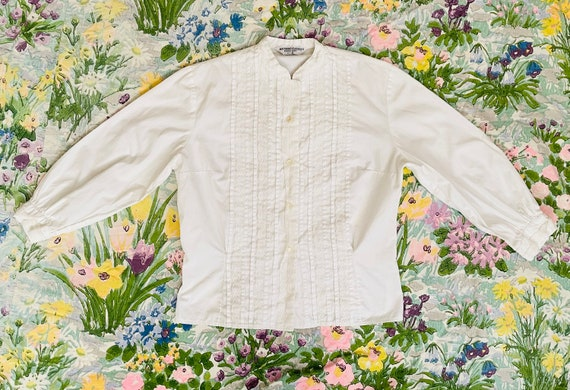 Vintage 1950s cream cotton blouse with eyelet details in a geometric pattern