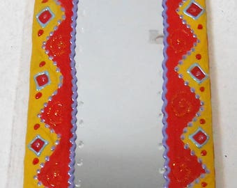 """small mirror painted """"DAKAR"""" 29 X 14 cm, yellow, red and purple for the happy home decor"""