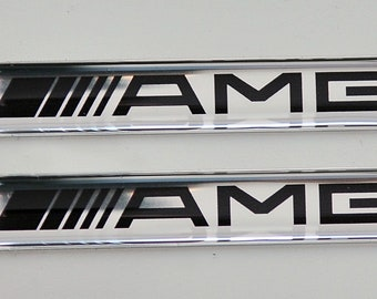 2 x Mercedes AMG Logo 3D Domed stickers. Size 60x10mm