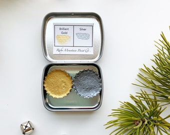 The Small Sparkle Set, a set of 2 metallic handmade watercolors in a new tin