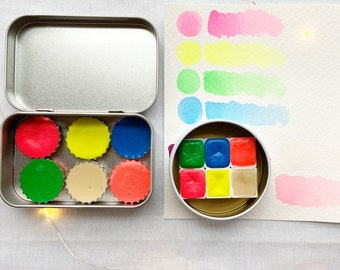 The Party Time 6 Set, a set of 6 colors of handmade watercolor paint in a new tin