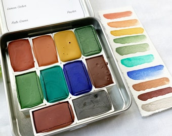 Late Summer Days Palette, a set of full pans of handmade watercolor paint in anew tin