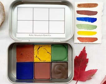 The Golden Mountains Set, a palette of 6 colors of handmade watercolor paint in a new tin