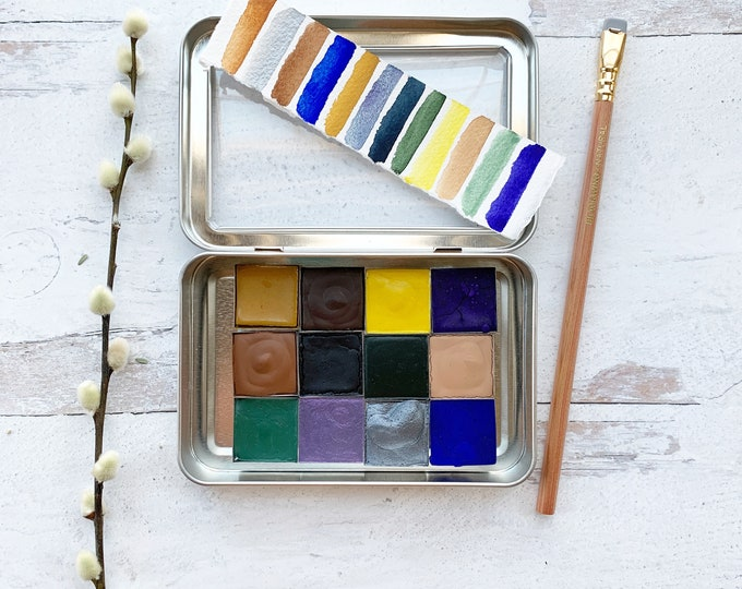 Featured listing image: The Shoreline Palette, a set of 12 colors of handmade watercolor paint in a new tin