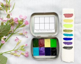 The June Traveler's Set, a set of 8 colors of handmade watercolor paint in a new tin