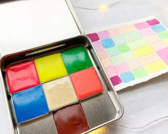 The Party Time Set, a set of 7 colors of handmade watercolor paint in a new tin